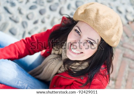 Young beautiful girl with winter clothes in the street - stock photo
