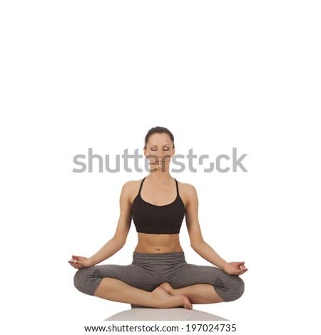young beautiful girl yoga posing on a white studio background  - stock photo