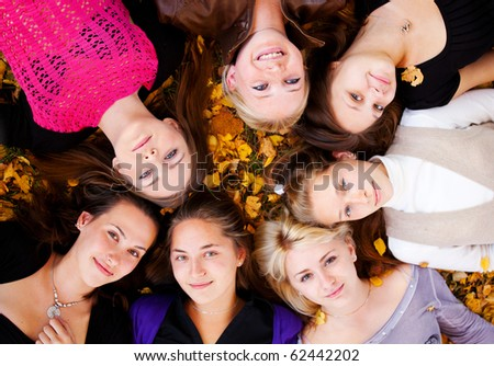 young beautiful girls lying on the grass - stock photo