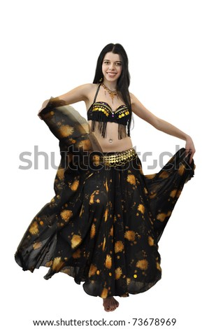 Young beautiful gypsy dancer in black and gold costume waving her skirt - stock photo