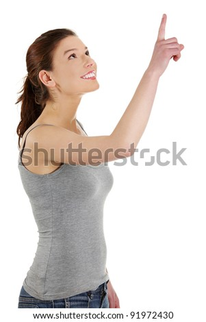 Young beautiful happy caucasian woman pointing up ,isolated on white - stock photo