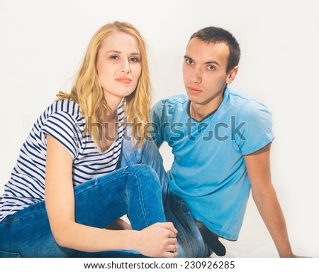 Young Beautiful Happy Couple in love woman and man studio portrait posing