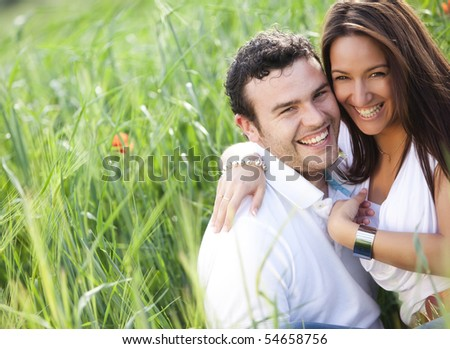 Young beautiful happy couple smiling at camera. - stock photo
