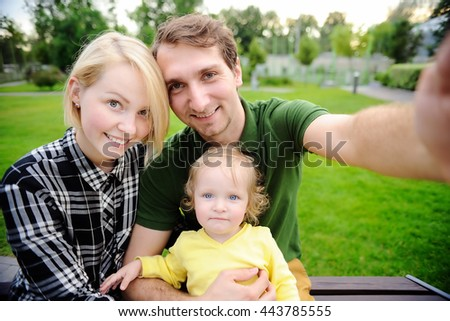 Young beautiful happy family making selfie photo together - stock photo