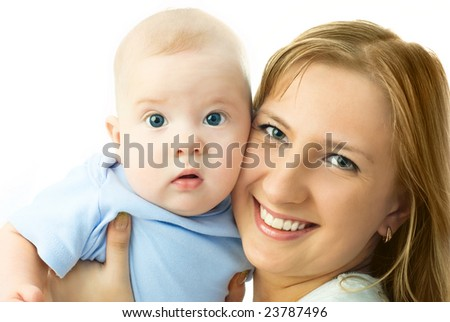 young beautiful happy mother holding her four months old baby and smiling