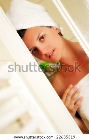 Young beautiful happy smiling tanned brunett woman at  shower in bathroom - stock photo