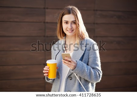young beautiful happy stylish hipster girl with cocktail, smoozy drink. - stock photo