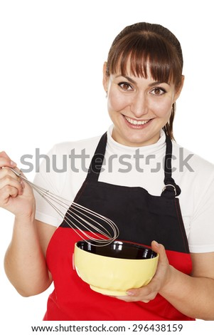 Young beautiful happy woman cooking - stock photo