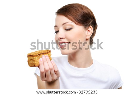 young beautiful happy woman eating cake - isolated - stock photo