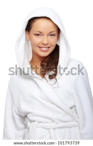 Young beautiful happy woman in bathrobe, isolated on white - stock photo