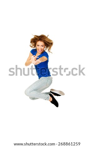 Young beautiful happy woman jumping. - stock photo