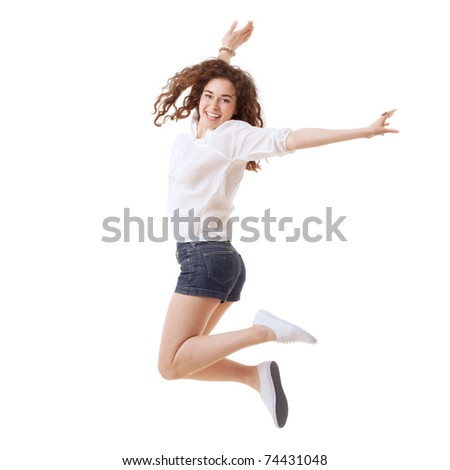 Young beautiful happy woman jumping against white background - stock photo