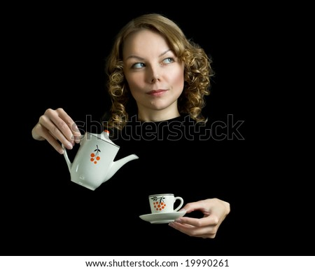 Young beautiful happy woman with teapot, indoors.