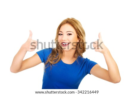 Young beautiful happy woman with thumbs up. - stock photo