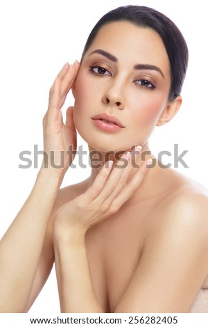 Young beautiful healthy woman touching her face, over white background - stock photo