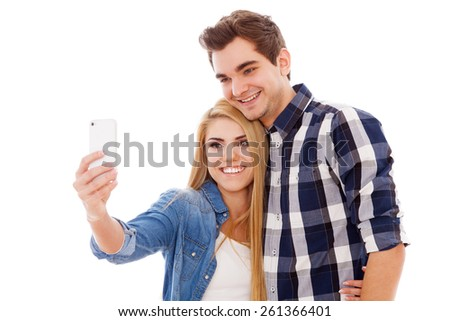 Young beautiful hipster couple making a selfie - stock photo