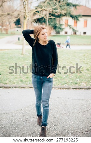 young beautiful hipster sporty blonde woman in town