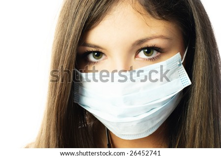 young beautiful hospital worker wearing protective mask against white background - stock photo