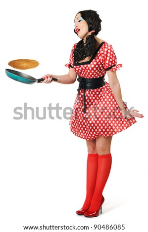 Young beautiful housewife with frying pan on white background, pinup concept - stock photo
