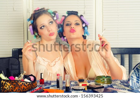 Young beautiful housewives having fun while beautifying themselves . - stock photo