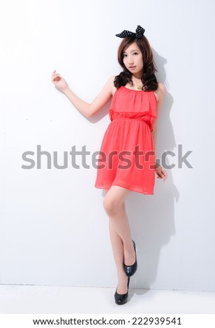 Young beautiful in fashion red gown posing  - stock photo