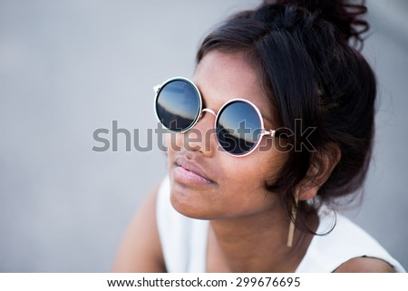 Young beautiful indian girl with glasses