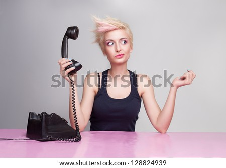 young beautiful lady does not care the phone - stock photo
