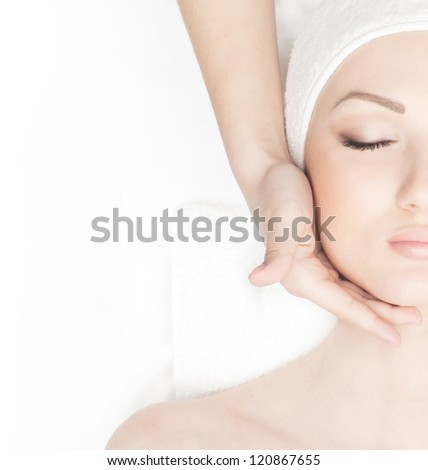 Young beautiful lady getting spa treatment - stock photo