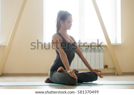 young attractive smiling woman practicing yoga stock photo