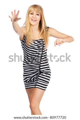 Young beautiful lady throwing something at camera - stock photo
