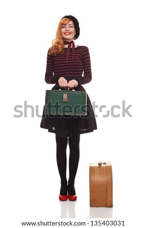 young beautiful lady with her retro suitcases is ready to go.isolated on white background - stock photo
