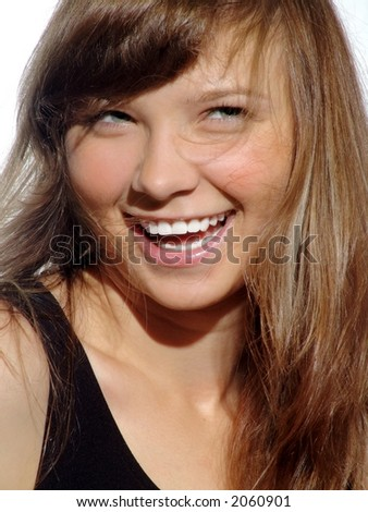 Young beautiful laughing girl with green eyes