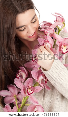 young beautiful long hair woman with pink orchid