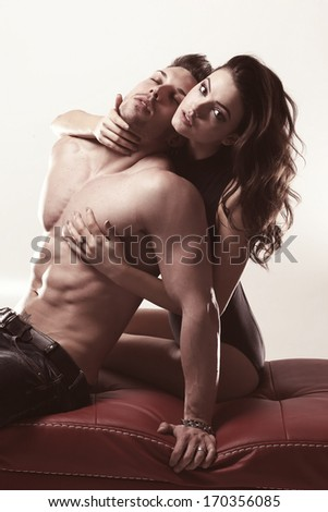 Young beautiful loving couple .Glamour color.  - stock photo