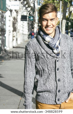 Young beautiful man smiling in a street - stock photo