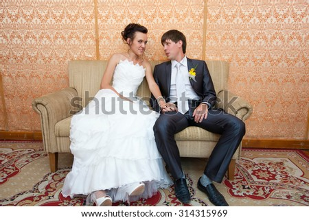 young beautiful marriage couple posing in beautiful interiors