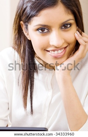 young beautiful middle eastern woman smiling