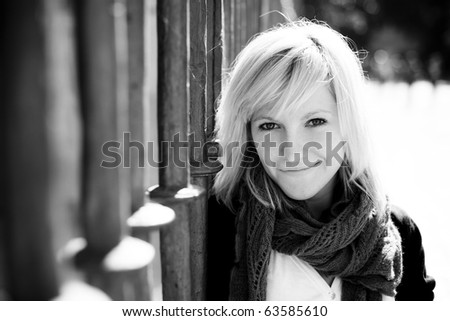 Young beautiful monochrome portrait of a blond girl. - stock photo