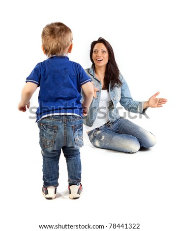 Young beautiful mother and her son having fun together