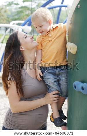 Young beautiful mother and son in the park.