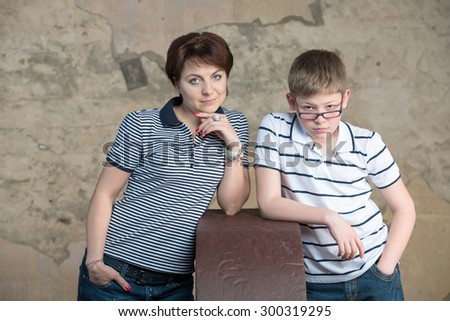 Young beautiful mother and son - teenager