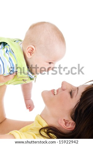 Young beautiful mother catching her innocent baby - stock photo