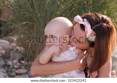 Young beautiful mother holding her baby