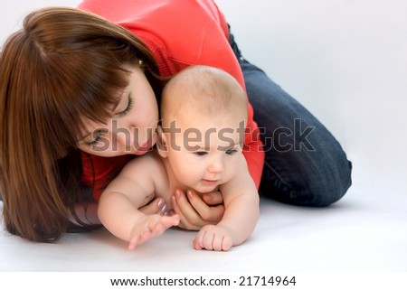 young beautiful mother with her baby - stock photo