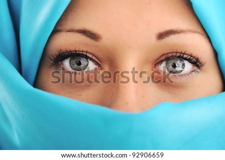 Young beautiful muslim woman in blue scarf - stock photo