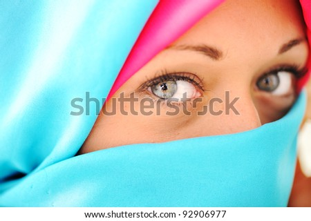Young beautiful muslim woman in blue scarf - stock photo