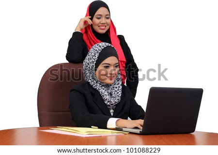 Young beautiful muslim women happy in business wear working in office together