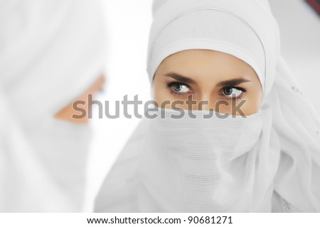 Young beautiful mysterious Muslim woman