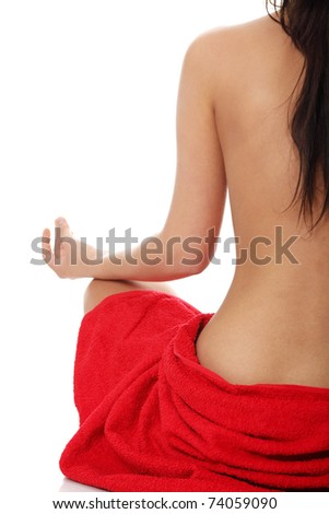 Young beautiful nude woman meditating , isolated on white - stock photo