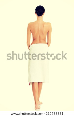 Young beautiful nude woman with towel , isolated on white